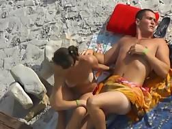 a beach couple fingerfucking