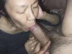 Asian MILF blowing