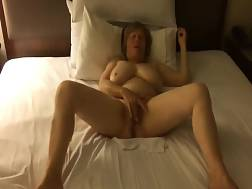mature woman rubs pussy
