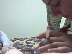 lady smokes cigarette blowing