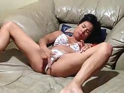 short-haired asian lady pleases