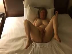 mature woman rubs pussy